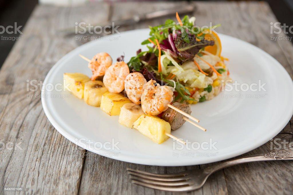 Fried shrimps skewer stock photo