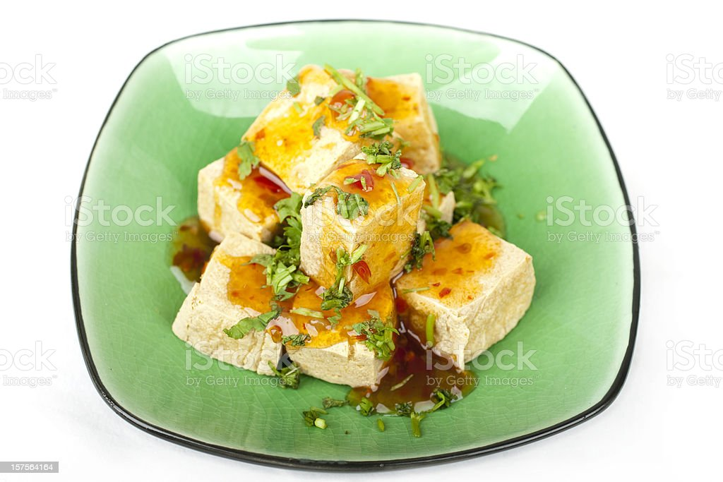 Fried squares of tofu served on green ceramic plate royalty-free stock photo