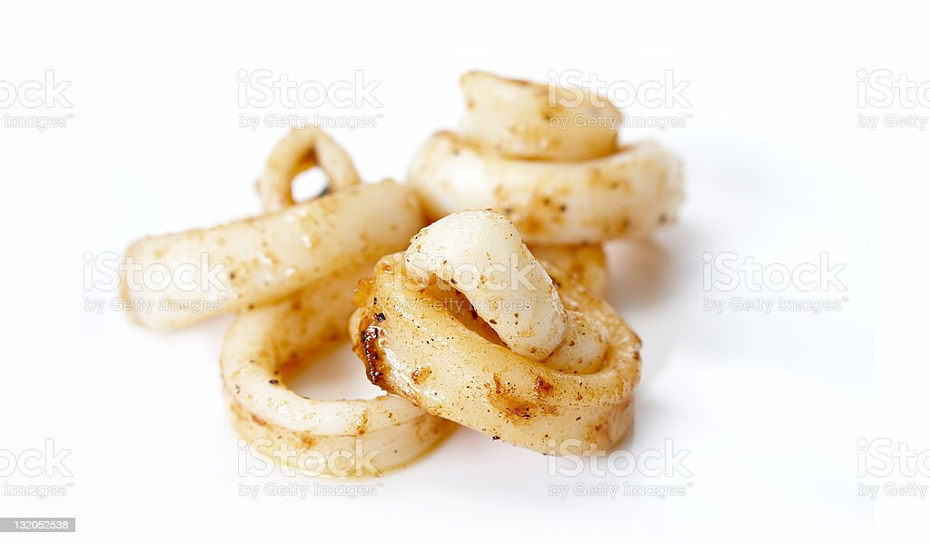 Fried squid rings on white surface royalty-free stock photo
