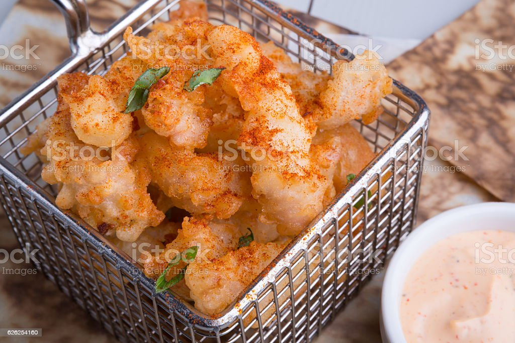 Fried squid with sauce stock photo