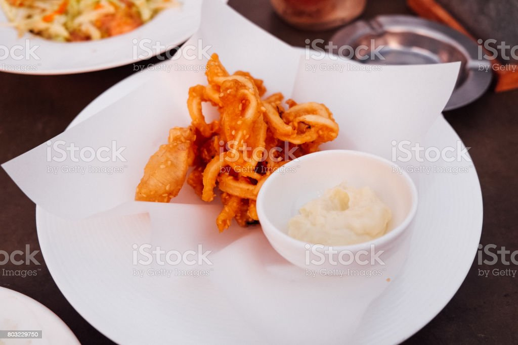 fried squid with tartar sauce  on white dish stock photo