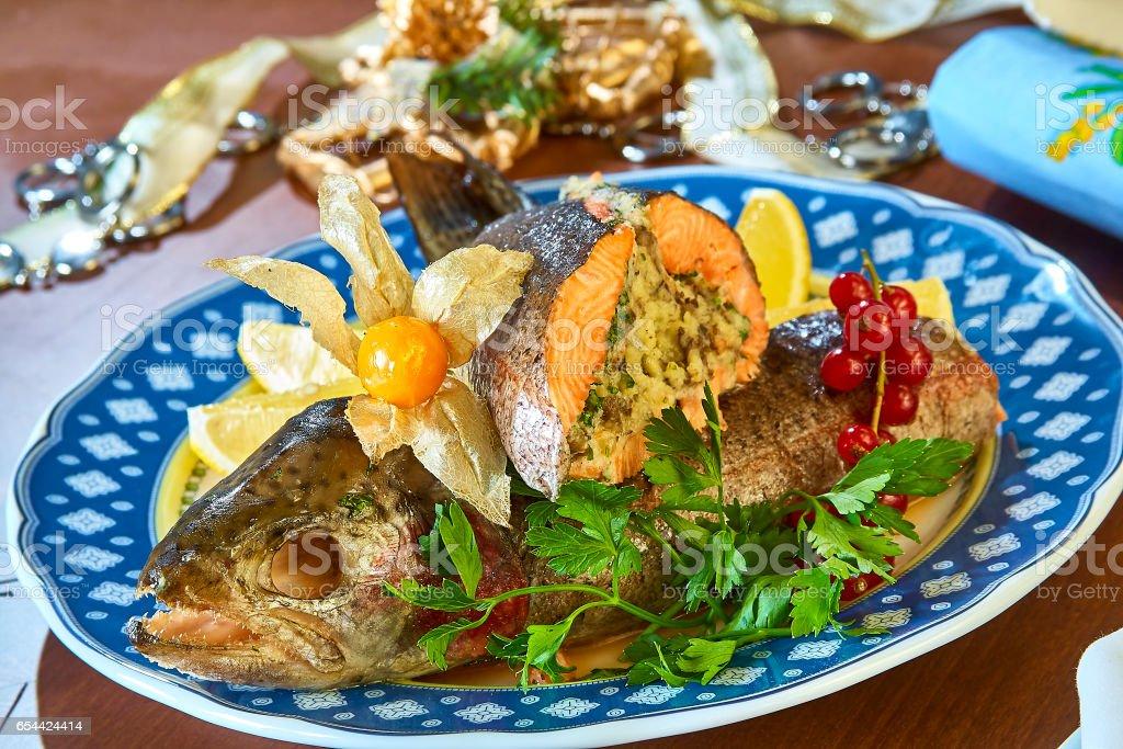 Fried stuffed fish on a platter festive menu stock photo