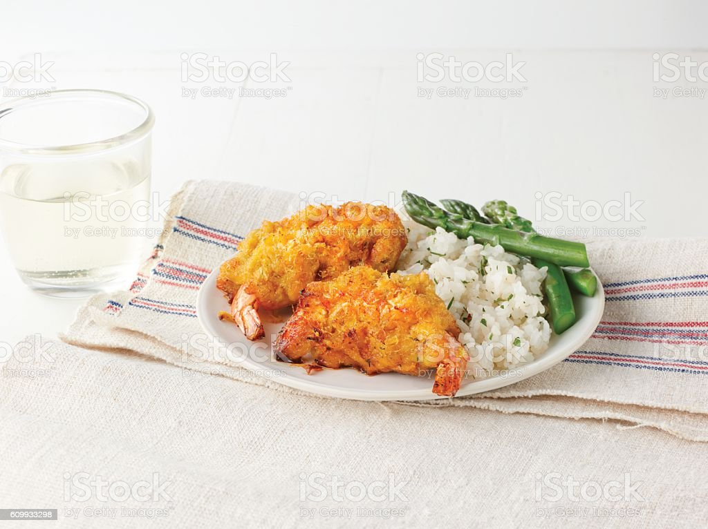 Fried stuffed shrimp with rice and asparagus on white plate stock photo