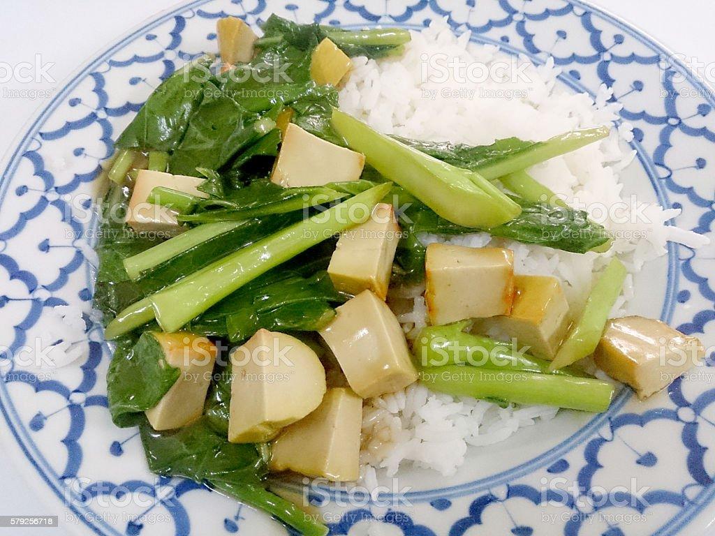Fried tofu with Chinese broccoli &  thai jasmine rice, stock photo