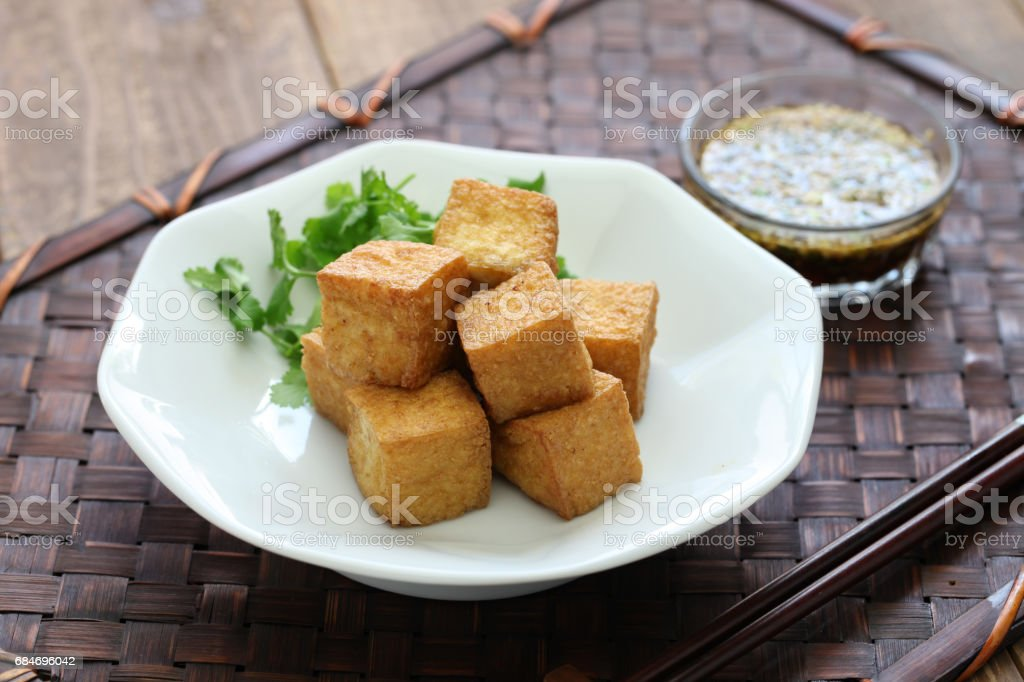 fried tofu with dipping sauce stock photo