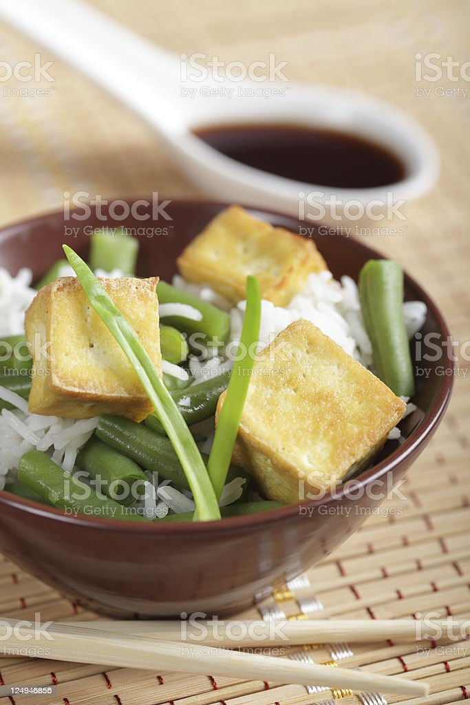Fried tofu with rice and vegetables stock photo