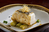 Fried toothfish with onion on dish