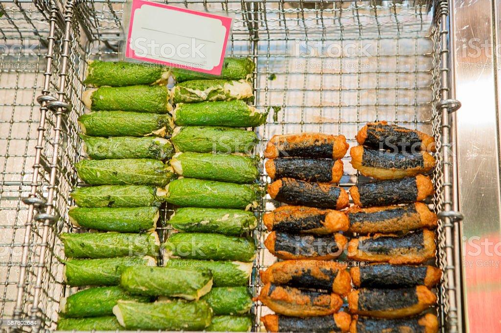 fried traditional japanese fastfood in kyoto nishiki fishmarket at japan stock photo