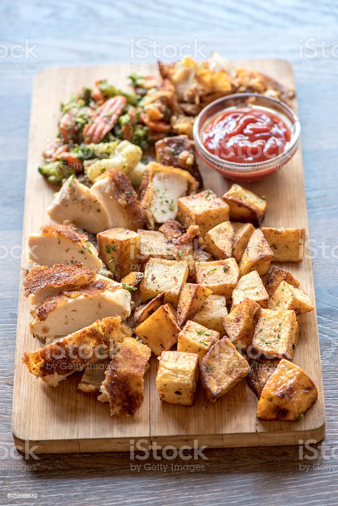 Fried turkey and potatoes stock photo