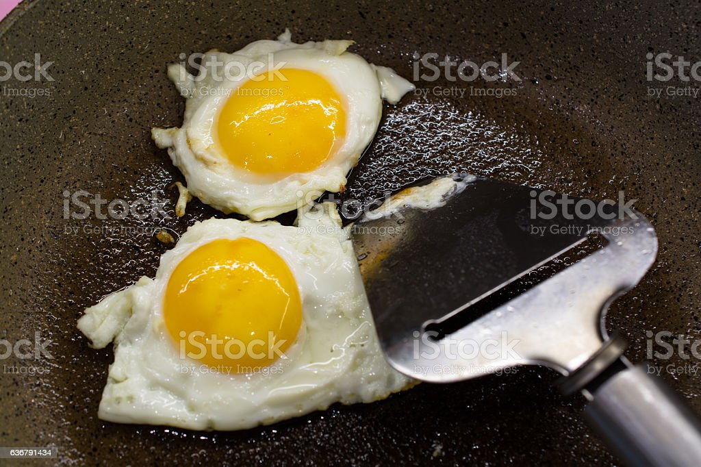 Fried two eggs on frying pan. stock photo
