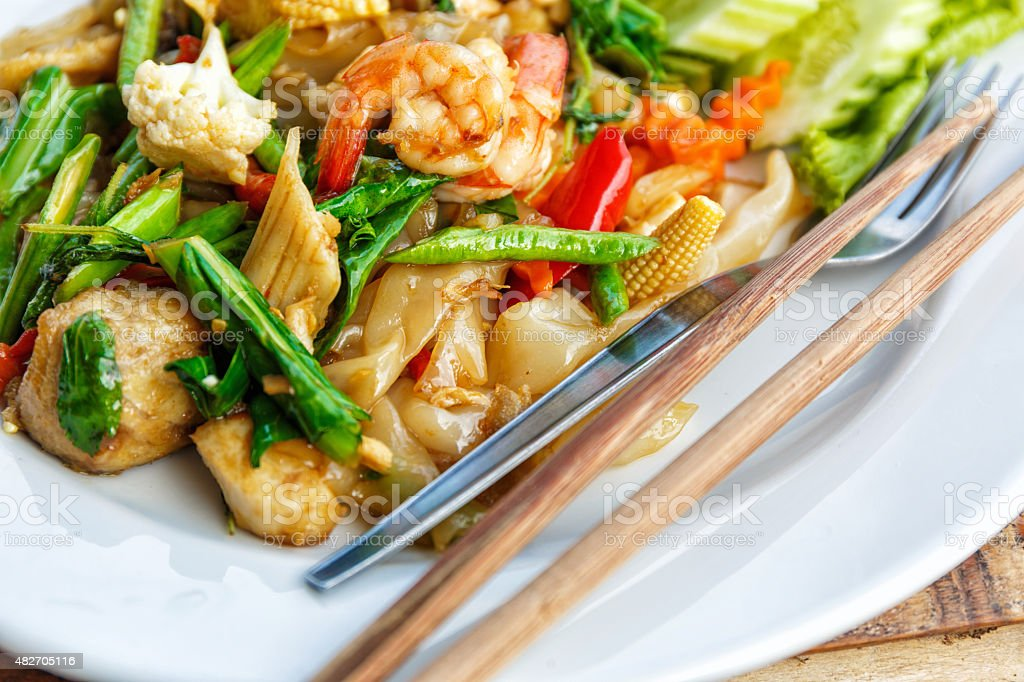 Fried vegetables and seafood in sauce stock photo
