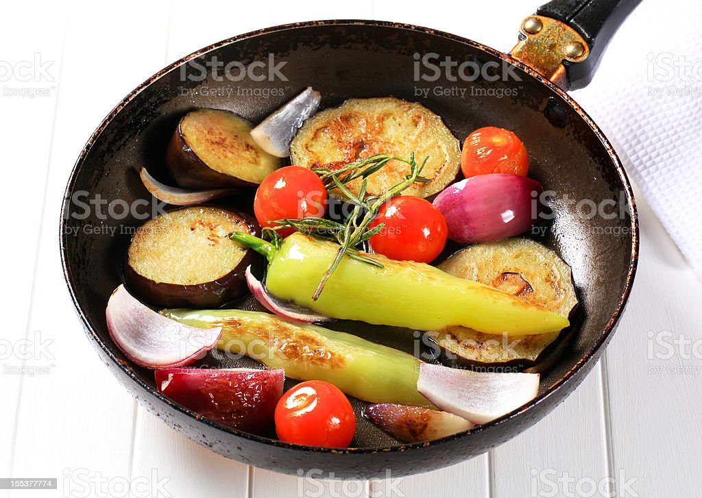 Fried vegetables in a pan royalty-free stock photo