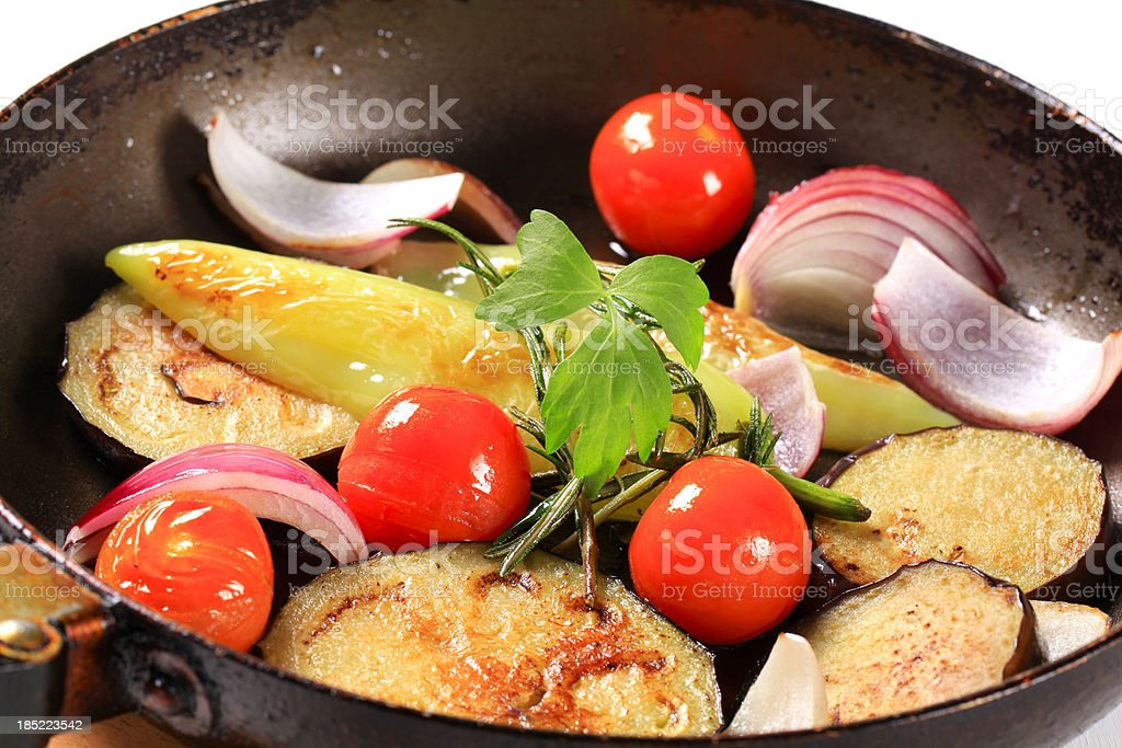 Fried vegetables in a pan stock photo