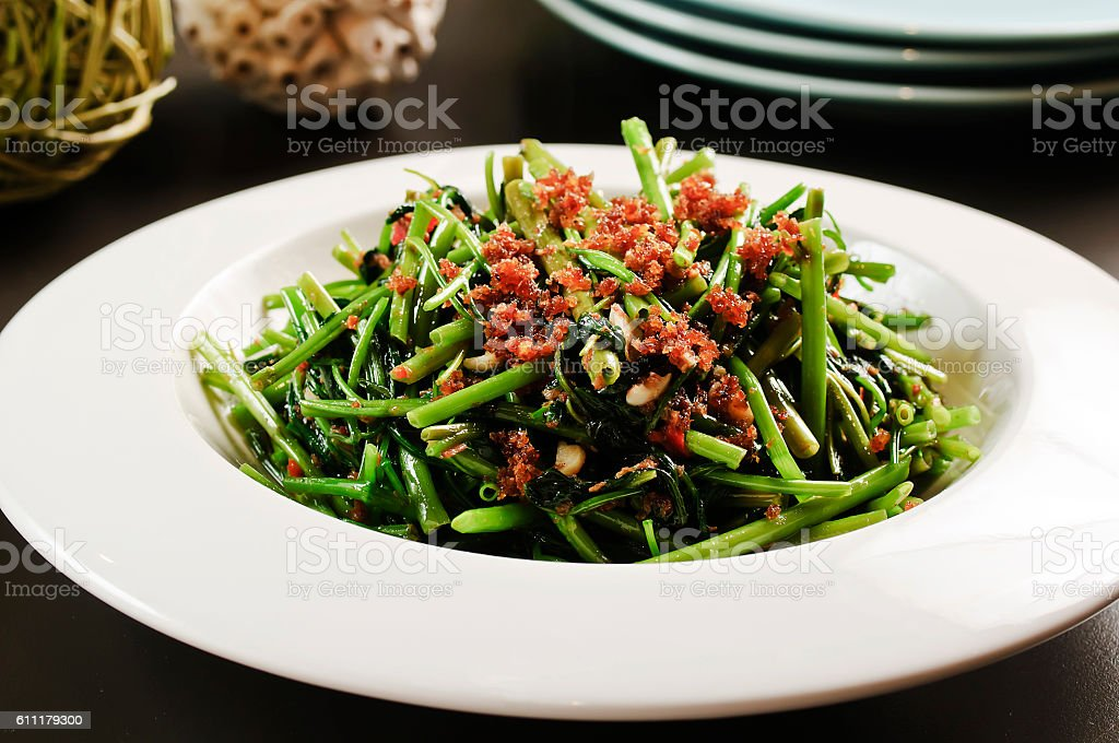 Fried vegetables of the morning glory or rau muong on stock photo