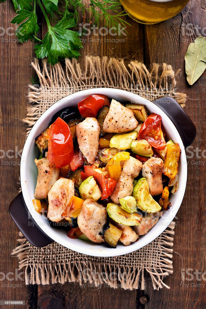 Fried vegetables with chicken meat stock photo