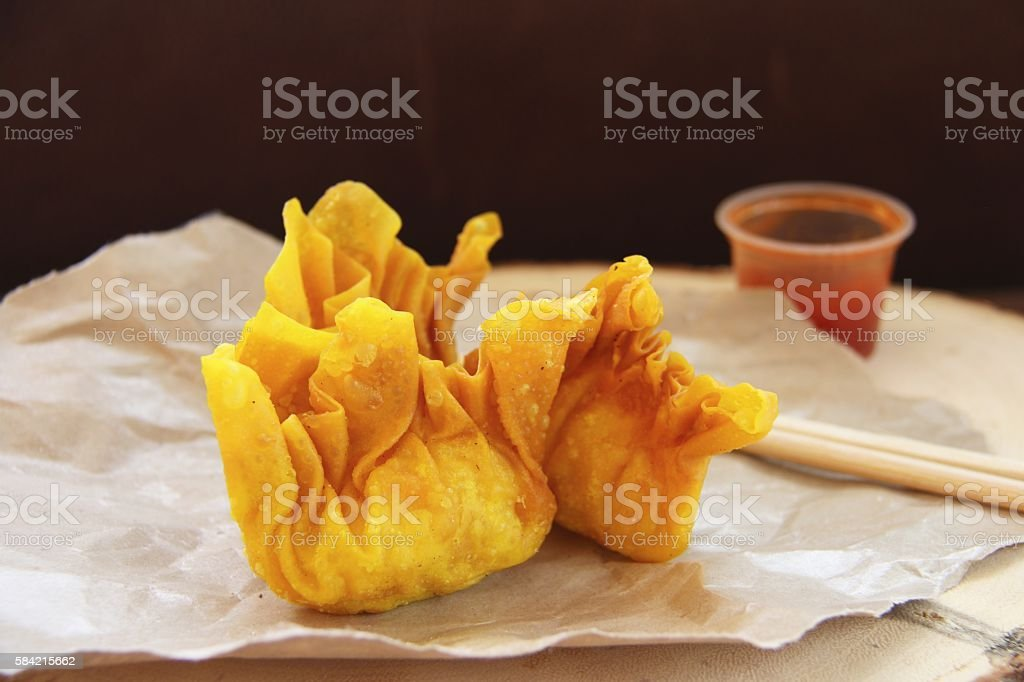 Fried Wontons on Crumpled Food Wrapping Paper stock photo