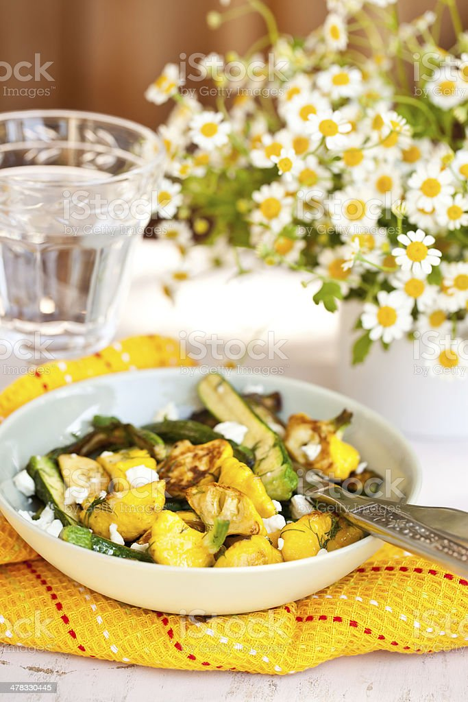 Fried Zucchini and Patty Pan Squash with white cheese royalty-free stock photo