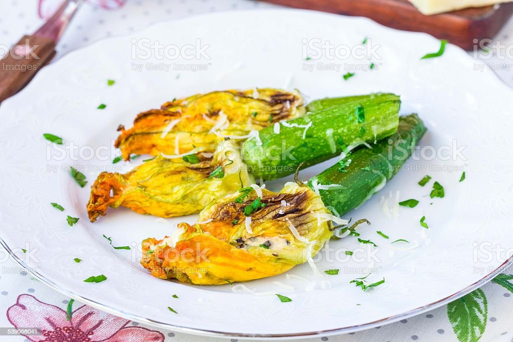 Fried zucchini flowers stuffed with cream cheese, ricotta, tasty stock photo