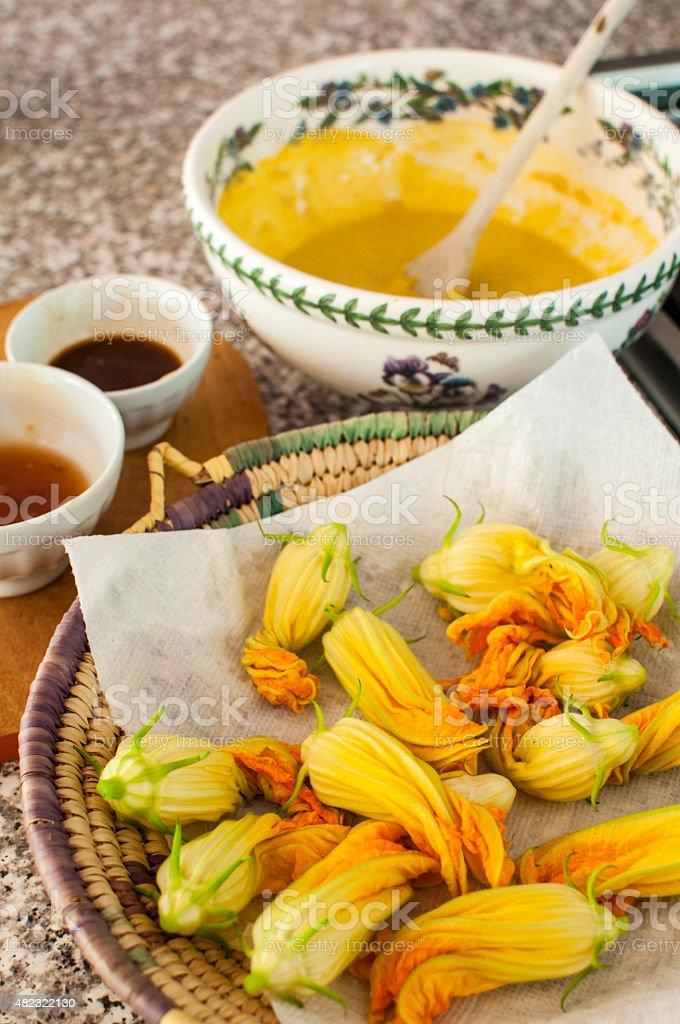 Fried zuchini flowers preparation stock photo