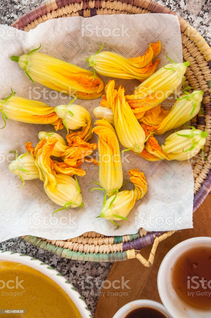 Fried zuchini flowers preparation stock photo