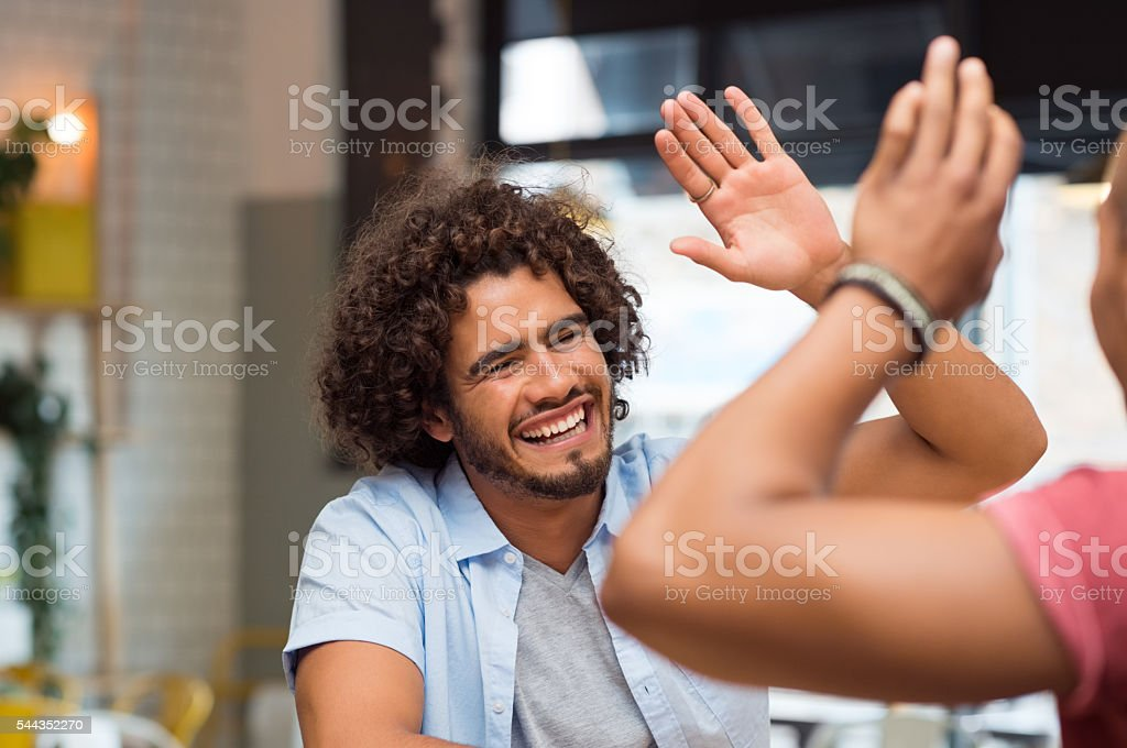 Friend giving high five stock photo