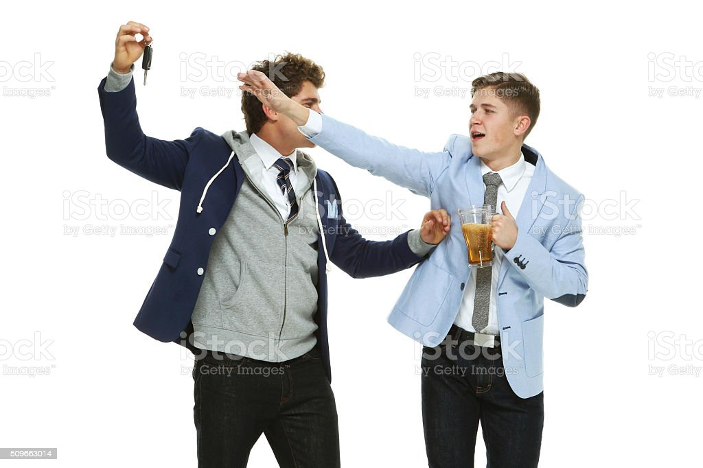 Friend preventing drunk driving stock photo