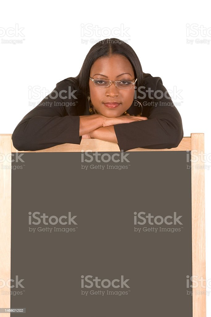 Friendly adult student leaning on chalk board royalty-free stock photo