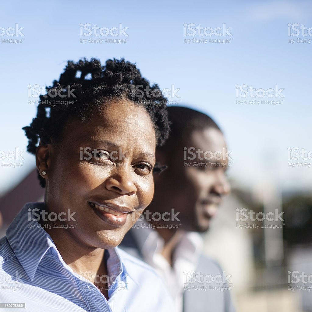 Friendly african businesswoman looking into camera royalty-free stock photo