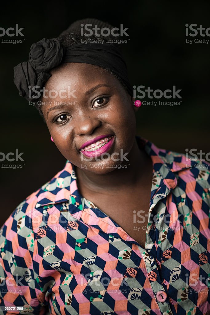 Friendly afro young woman pink visual stock photo
