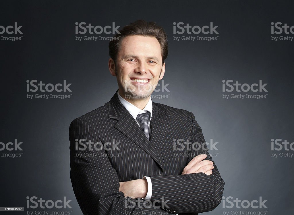 friendly and self-confident businessman royalty-free stock photo