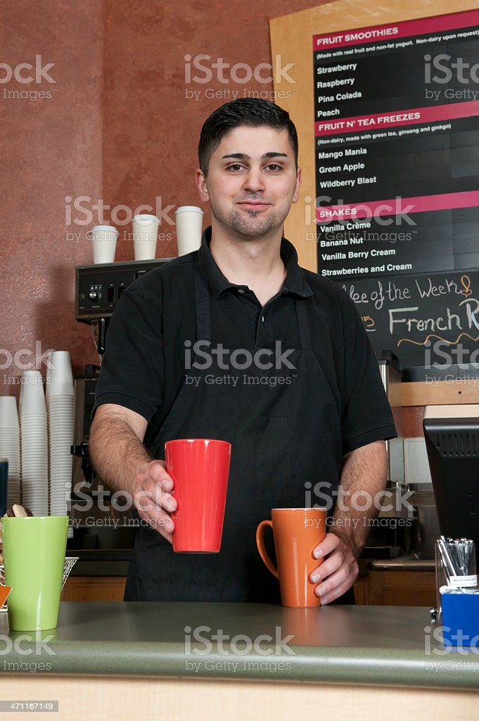 Friendly Barista at a Coffee Shot royalty-free stock photo