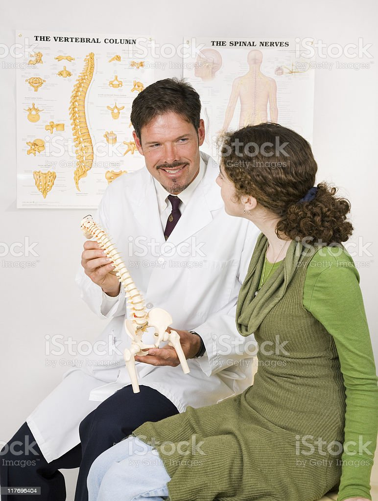 Friendly Chiropractor with Patient royalty-free stock photo