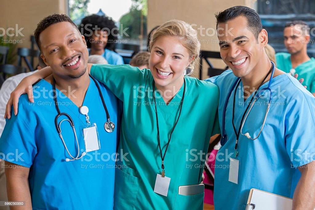 Friendly colleagues at a medical conference stock photo