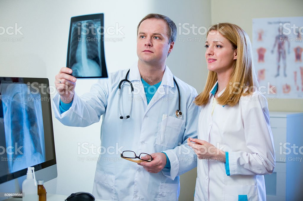 Friendly confident doctors with x-ray image stock photo