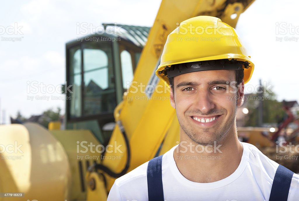 Friendly construction worker with his excavator royalty-free stock photo