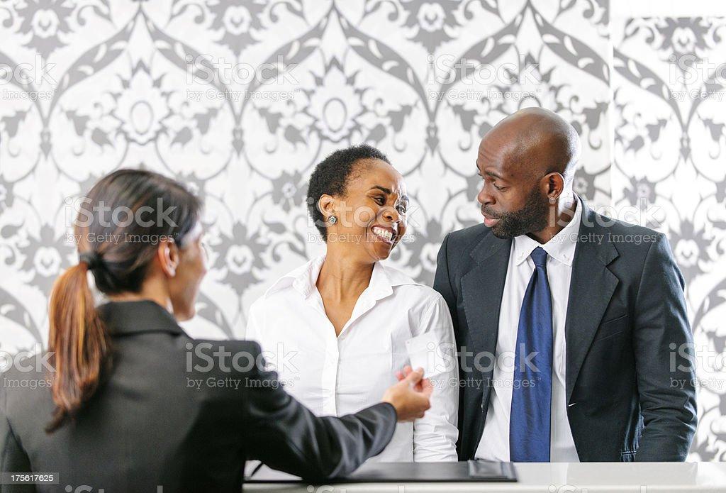 Friendly couple checkin at hotel royalty-free stock photo