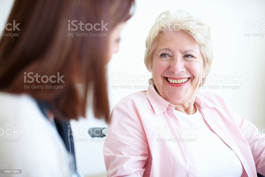 Friendly doctor and patient relations - Senior Health royalty-free stock photo