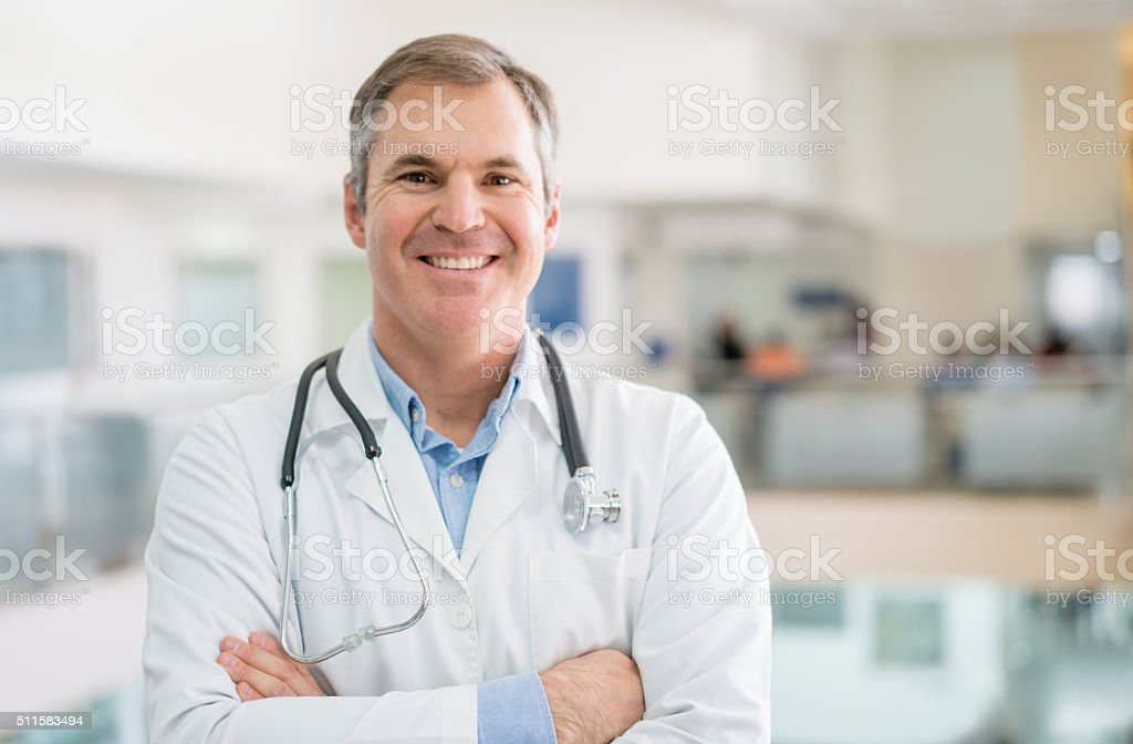 Friendly doctor at the hospital stock photo