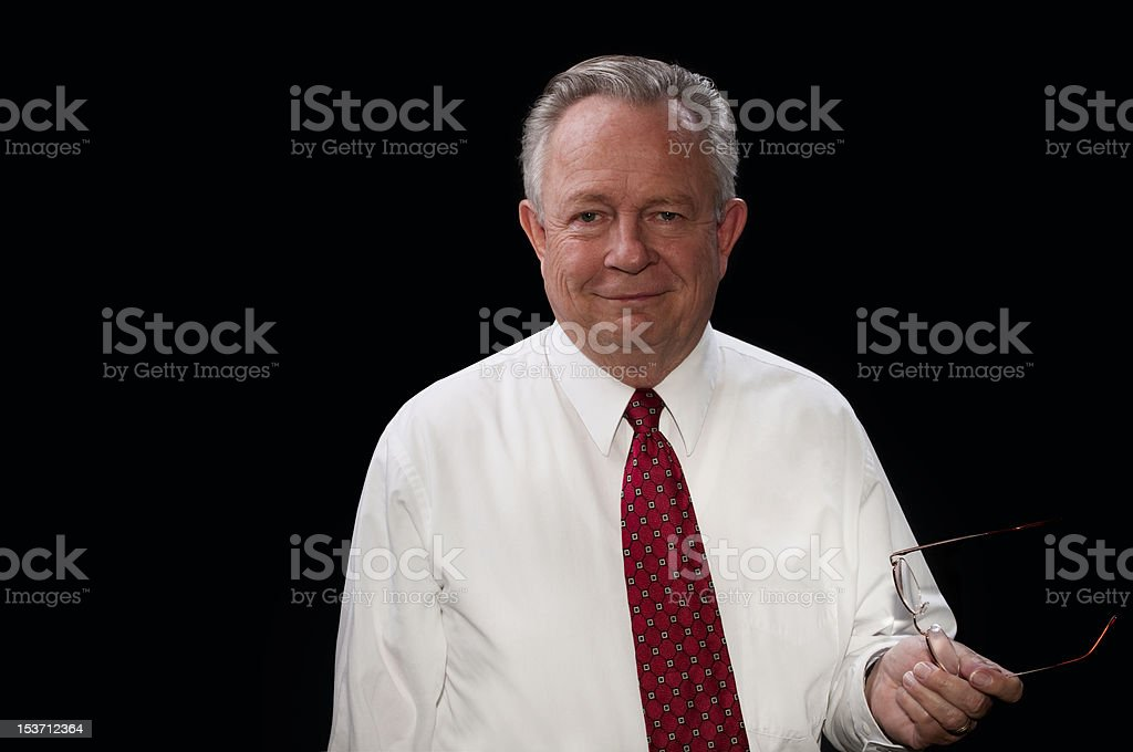 Friendly Executive Man in White Shirt and Tie Against Black royalty-free stock photo