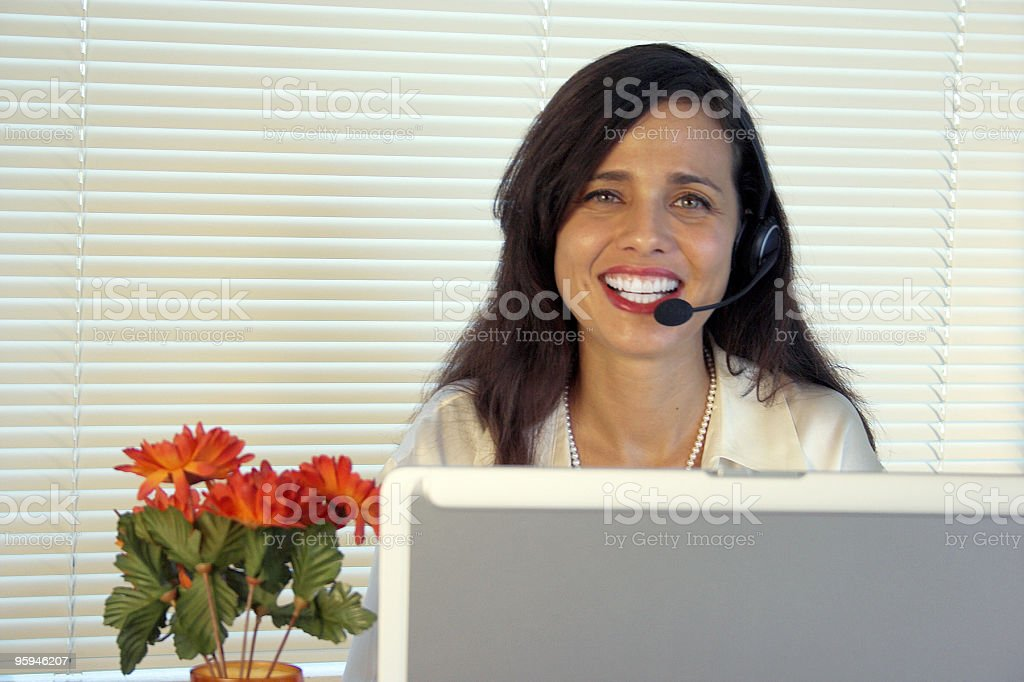 Friendly Female Customer Service Representative royalty-free stock photo