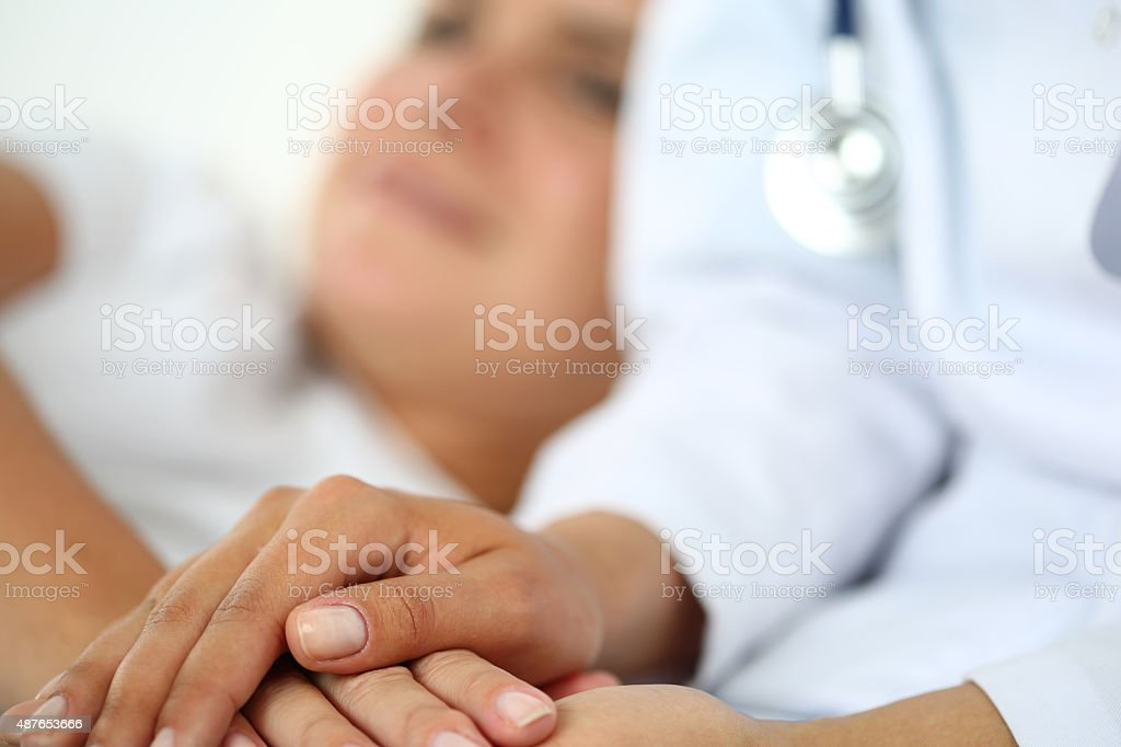 Friendly female doctor hands stock photo