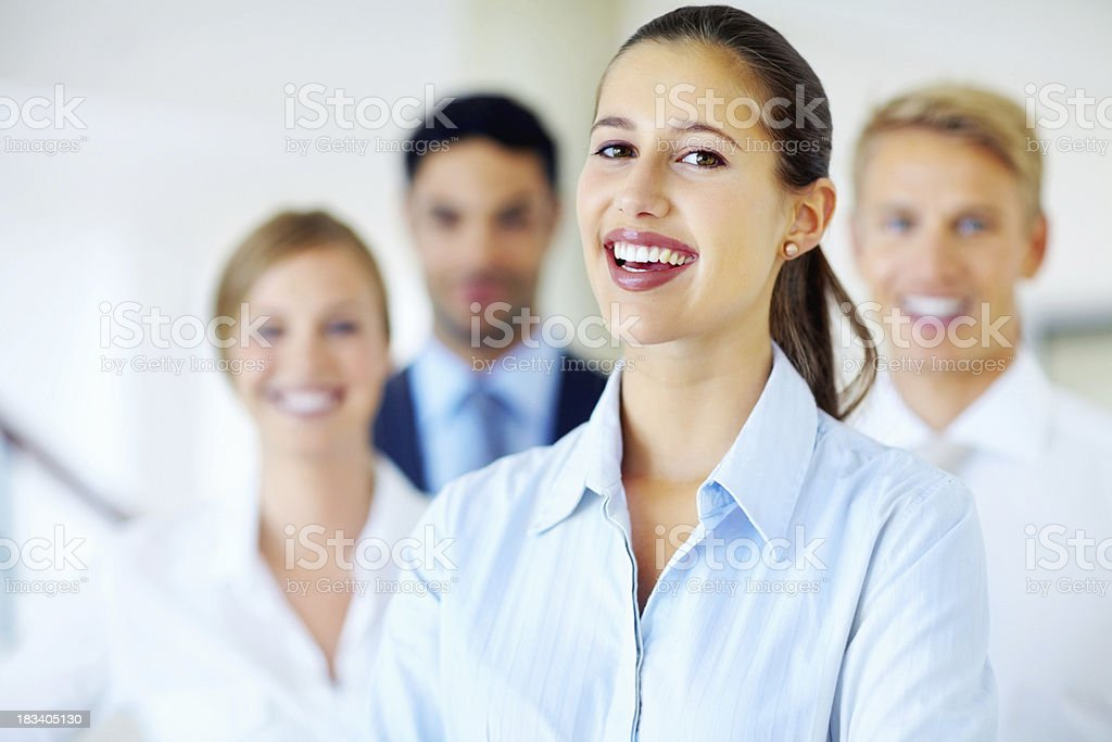 Friendly female leader with her team royalty-free stock photo