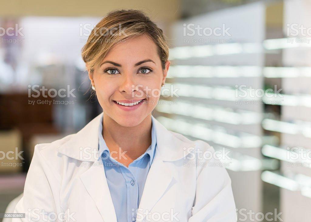 Friendly female optician at the optics stock photo