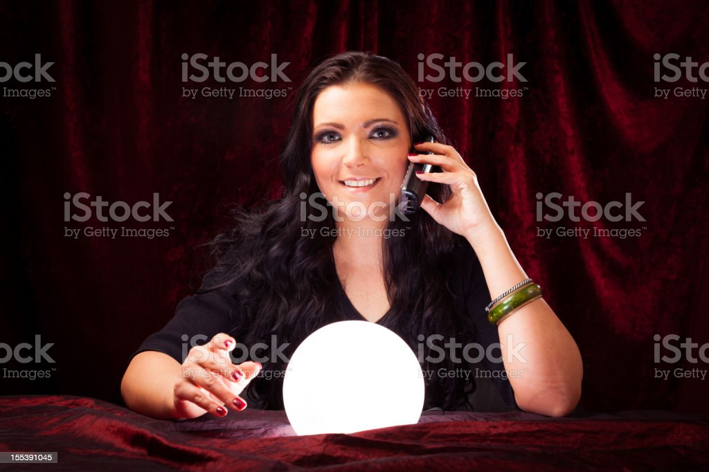 friendly fortune teller with crystal ball stock photo