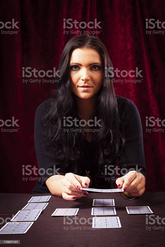 friendly fortune teller with tarot cards stock photo