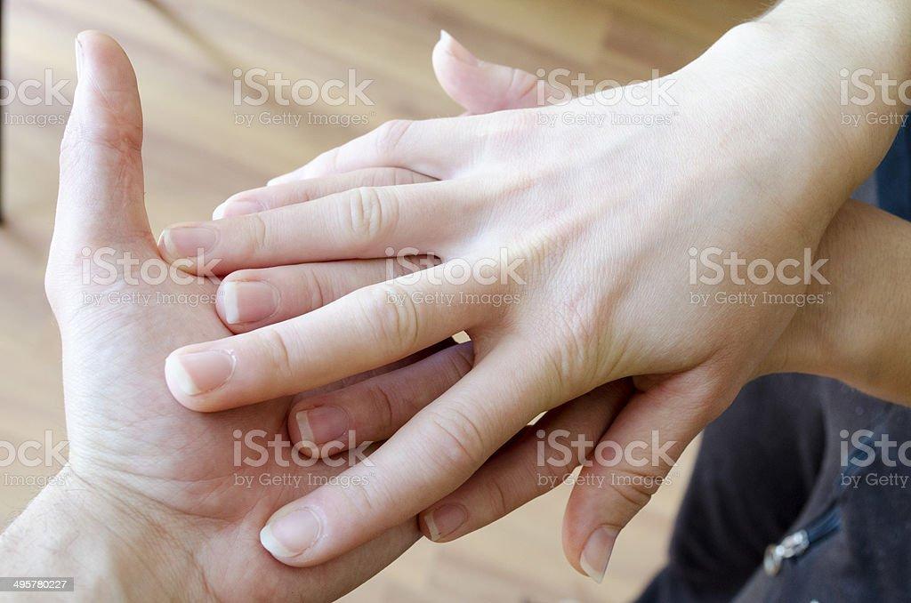 Friendly Handshake. Man And Woman Shaking Hands. stock photo