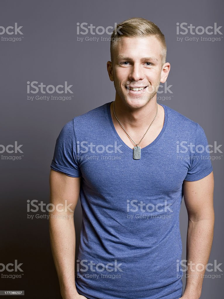 Friendly handsome fit young man. stock photo