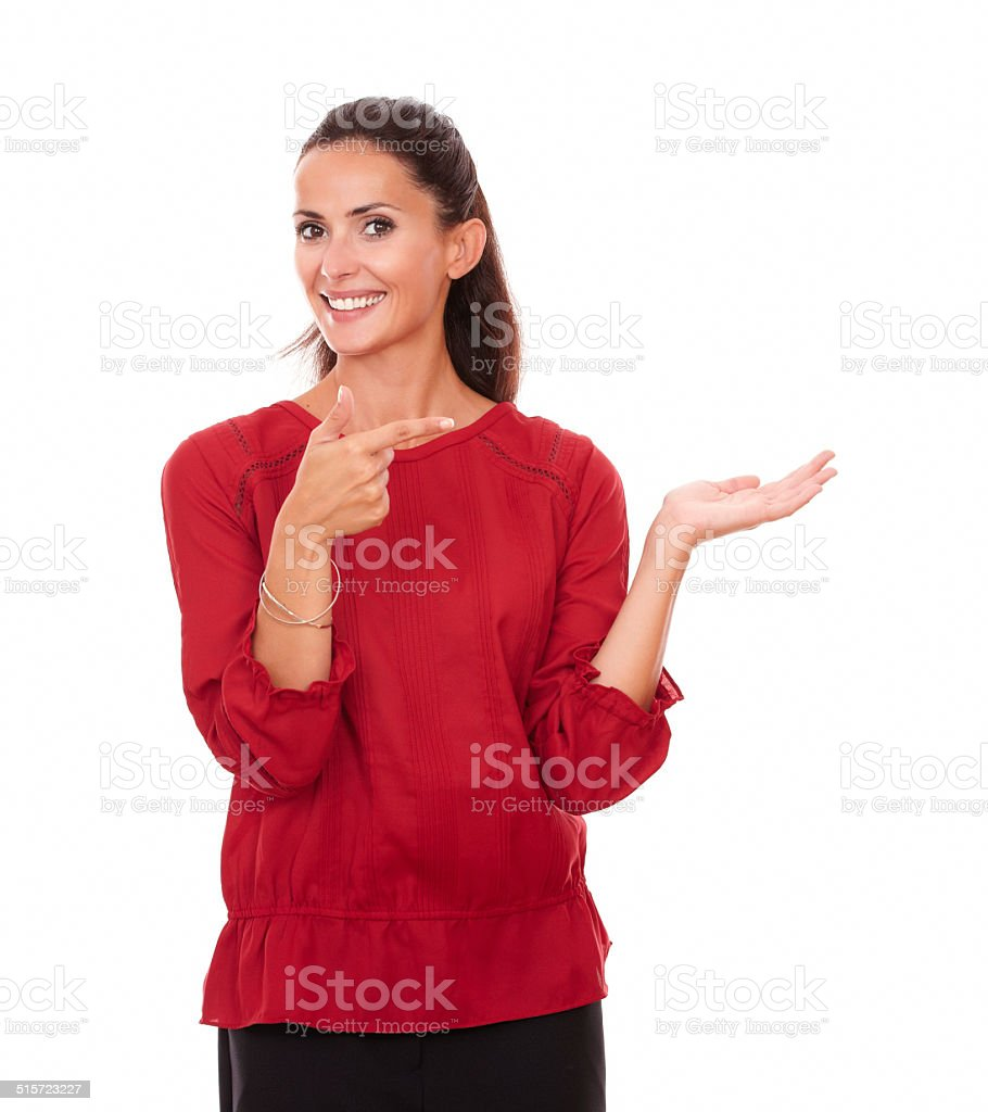 Friendly hispanic female holding her left palm up stock photo