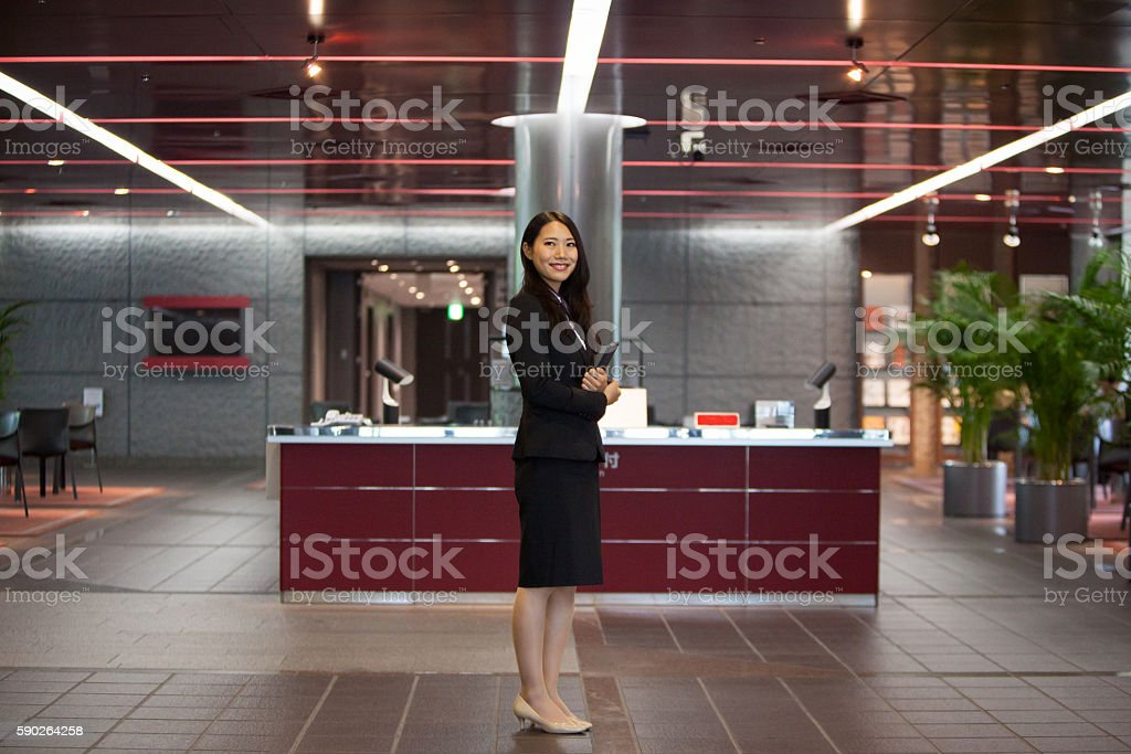Friendly hotel staff greets at the entrance stock photo