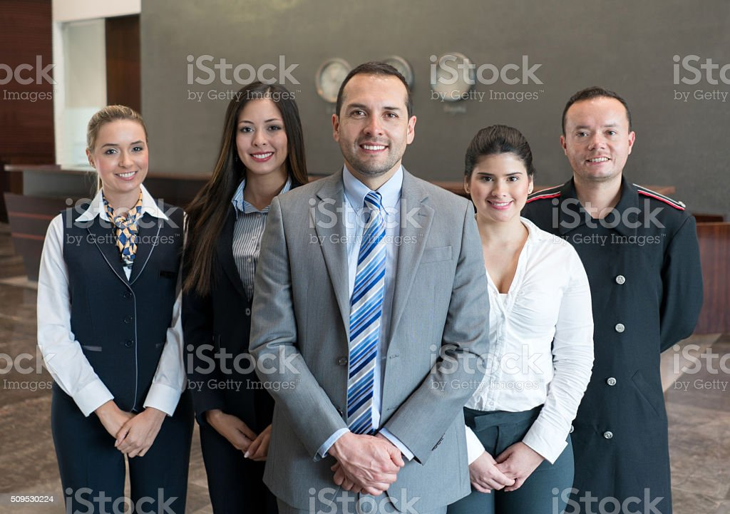 Friendly hotel staff smiling stock photo